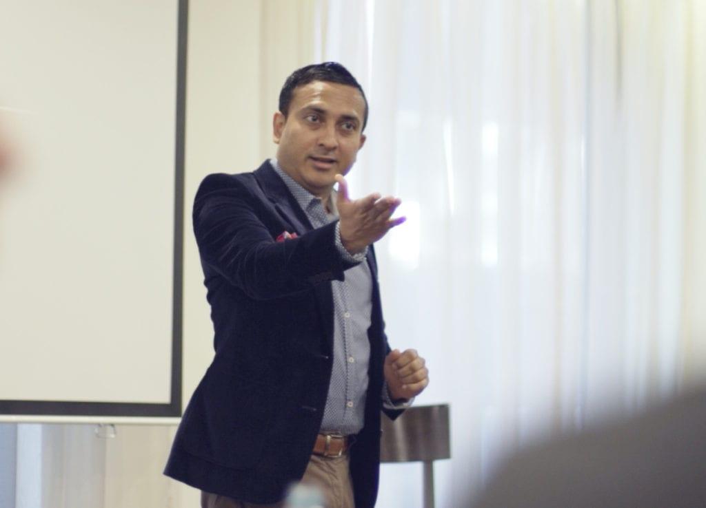 Dr Kinnar Shah Explaining his business coaching techniques